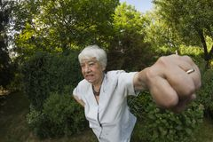 Eldery, gray woman outdoors Royalty Free Stock Photography
