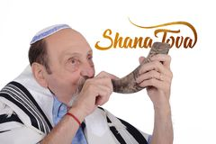 Eldery jewish man blowing the Shofar horn stock photos