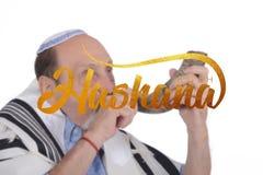 Eldery jewish man blowing the Shofar horn royalty free stock photography