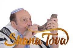Eldery jewish man blowing the Shofar horn stock photo