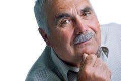 Eldery mężczyzna z kierowniczy odpoczywać na rękach Obraz Stock
