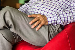 Eldery man hand. Sitting at home Stock Image
