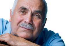 Eldery man with head resting on arms Royalty Free Stock Photo