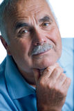 Eldery man with head resting on arms Stock Images