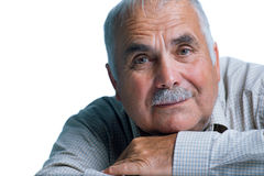 Eldery man with head resting on arms Stock Photos
