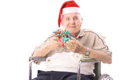 Eldery man in wheelchair celebrating christmas. Isolated on a white background Stock Photo