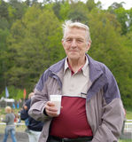 Eldery men with pot of beer Stock Photography