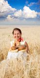 Eldery woman  with bread Stock Photo