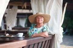 An eldery woman sitting in the coffe house. Stock Photography