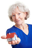 Eldery woman with small house Stock Photo
