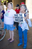 Eldery Woman Supports Wisconsin Worker Union. Elderly female supporter holding sign that says Save the American Dream at a rally at the Hawaii State Capitol in Royalty Free Stock Photos