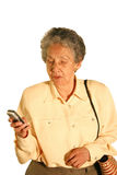 Eldery woman texting Royalty Free Stock Images
