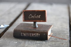 Elearning creative idea. Book - computer and inscription university, vintage style stock photos