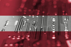 Elecectric circuit board background with blending Austria flag stock image