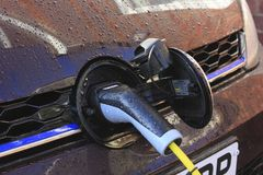 Elecrto car is charging by cable royalty free stock photo