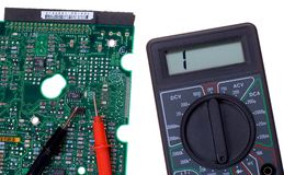 Elecrtonics. Printed circuit board and multimeter stock photography