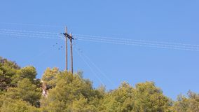 Electicity wires hanging in the blue sky. Selective focus royalty free stock photos