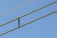 Electicity wires hanging in the blue sky. Selective focus stock photography