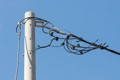 Electicity wires hanging in the blue sky. Selective focus royalty free stock images
