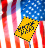 Election Ahead Sign. With the american flag on a background stock images