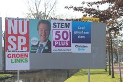 Election campaign posters on public billboards pasted by parties themselves in nIeuwerkerk aan den Ijssel in the Netherlands. Election campaign posters on royalty free stock photos
