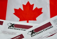Free Election Canada Voter Information Cards Over Small Canadian Flag Royalty Free Stock Image - 160983706