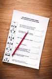 Election of a candidate. Election of the presidential candidate. Presidential elections. List of selections, put a tick, pen, pencil on wooden background Stock Photo