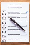 Election of a candidate. Election of the presidential candidate. Presidential elections. List of selections, put a tick, pen, pencil on wooden background Stock Photos