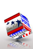 Election day campaign vote. Election day vote cube with reflection on a table Royalty Free Stock Images