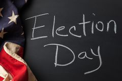 Election Day Sign. Handwritten on a chalkboard bordered by a vintage American flag Stock Photos