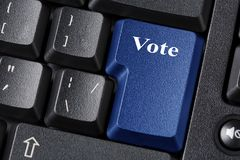 Election or democracy concept with blue Vote button on black keyboard. Close up. Election or democracy concept with blue Vote button on black keyboard. Close up stock images