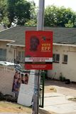Election flier on a utility pole in Johannesburg. Paper sign for a political candidate on a light pole in a southern suburb of Johannesburg, South Africa Stock Photo