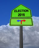 Election 2016 left or right ahead sign. Conceptual sign election 2016 left or right over dramatic  blue sky Royalty Free Stock Image