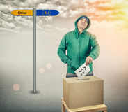 Election. The man at the ballot box voting Royalty Free Stock Photo