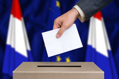 Election in Netherlands - voting at the ballot box. Election in Netherlands. The hand of man putting his vote in the ballot box. Netherlands and European Union Stock Photos