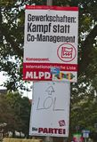 Election poster of the German Marxist Leninist Party with a funny poster of the satirist group Stock Image