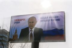 2018 Election poster in Russia on a billboard featuring Vladimir Putin with the slogan A strong president is a strong Russia. Campaign poster for the Election Royalty Free Stock Photography