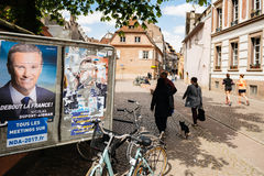 Election posters on election first day camapign. STRASBOURG, FRANCE - APR 26, 2017: Street view of multiple vandalized elections posters on the first round of Royalty Free Stock Photography