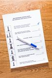 Election of a candidate. Election of the presidential candidate. Presidential elections. List of selections, put a tick, pen, pencil on wooden background Royalty Free Stock Photo