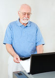 Election Senior Man Votes. Senior man voting on a new optical scanner machine at the polls Royalty Free Stock Photography