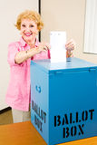 Election - Senior Woman Votes. Senior woman casting her vote in the election Royalty Free Stock Photos