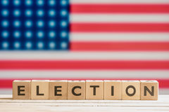 Election sign with the american flag. Election sign on a table with the american flag Stock Photos