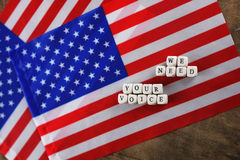 Election simbol on usa flag. Many cubes with letter Royalty Free Stock Photo