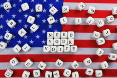 Election simbol on usa flag. Many cubes with letter Stock Photos
