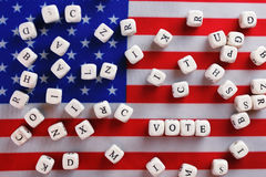Election simbol on usa flag. Many cubes with letter Stock Photography