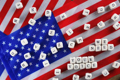 Election simbol on usa flag. Many cubes with letter Stock Image