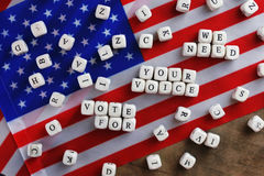 Election simbol on usa flag. Many cubes with letter Stock Images