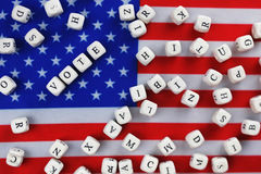Election simbol on usa flag. Many cubes with letter Royalty Free Stock Images