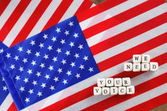 Election simbol on usa flag. Many cubes with letter Royalty Free Stock Photography