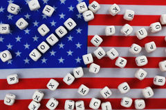 Election simbol on usa flag. Many cubes with letter Stock Photo